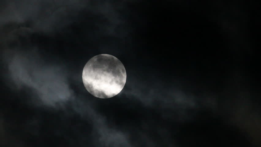 Eerie clouds move over a full moon at night   Shutterstock HD Video #14535676
