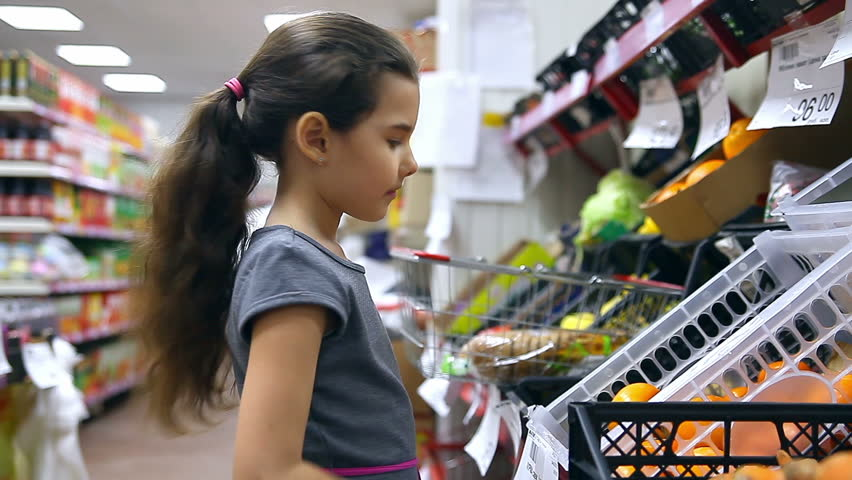 Girl teen  in supermarket to buy persimmon fruit food  | Shutterstock HD Video #14547916