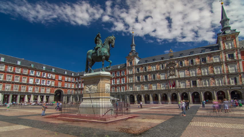 Statue of Philip III timelapse hyperlapse at Mayor plaza in Madrid in a beautiful summer day, Spain