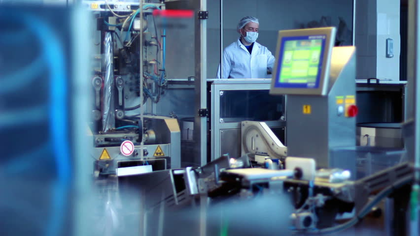 Factory worker at industrial workshop/Modern food technology/Food industry/Dairy factory/Automated production line/Packaging machine/Packaged food on computer controlled conveyor/Industrial equipment | Shutterstock Video #14579476