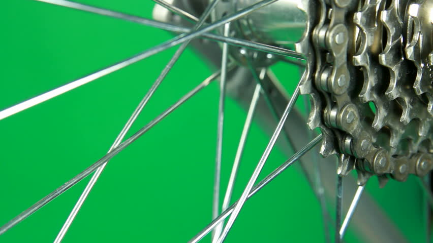 in close-up bicycle gear and wheel starting work and stop at the end isolated on chrome key