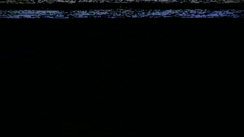 VCR Video Static Noise. Video noise from a video cassette player. VHS or Betamax. With dark noisy sections, and static. All original elements. Captured with a 4K camera.