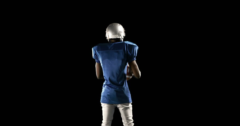 American football player playing on black background   Shutterstock HD Video #14612416
