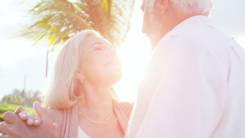 Senior Caucasian couple dancing together by a Caribbean beach | Shutterstock HD Video #14614186