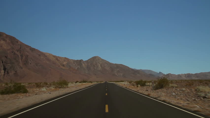 Driving shot on an empty road in Death Valley National Park