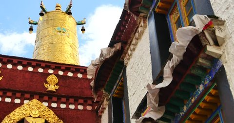 4k closeup of The Jokhang Temple In Lhasa,Tibet,white clouds in blue sky. gh2_09670_4k