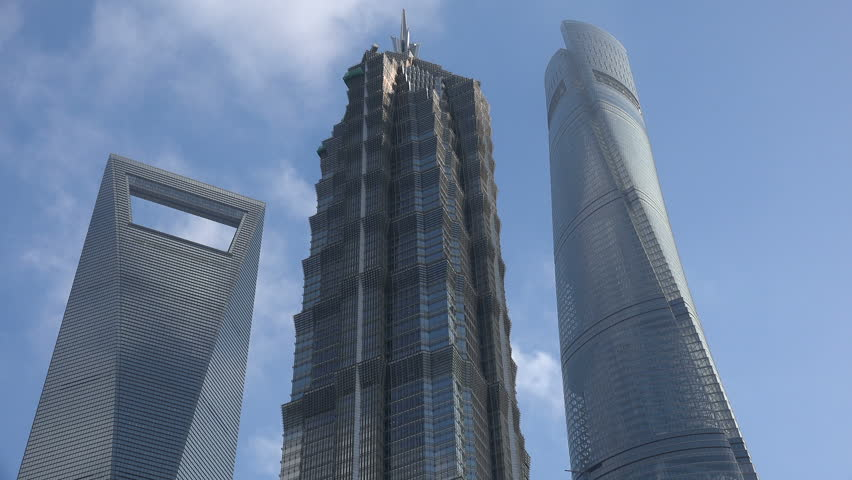 SHANGHAI, CHINA - 6 NOVEMBER 2015: Timelapse video of clouds moving over Shanghai's three tallest skyscrapers,  the Shanghai World Financial Center, the Jin Mao Tower, and the Shanghai Tower