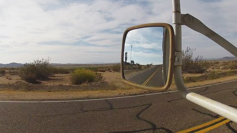 BARSTOW, CALIFORNIA/USA: June 14, 2015- The stabilized side view of a driver of a truck or RV as he rolls through the Mojave Desert on Route 66 between Victorville and Barstow California.