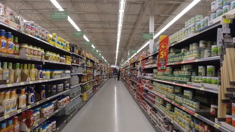 MONTREAL, CANADA - FEBRUARY 2016: Slow Motion: Walking through Walmart aisle (Mayo, oils, food cans, sauces etc.)