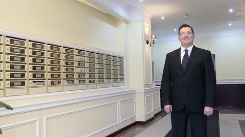 Apartment Concierge: Man on mailboxes background