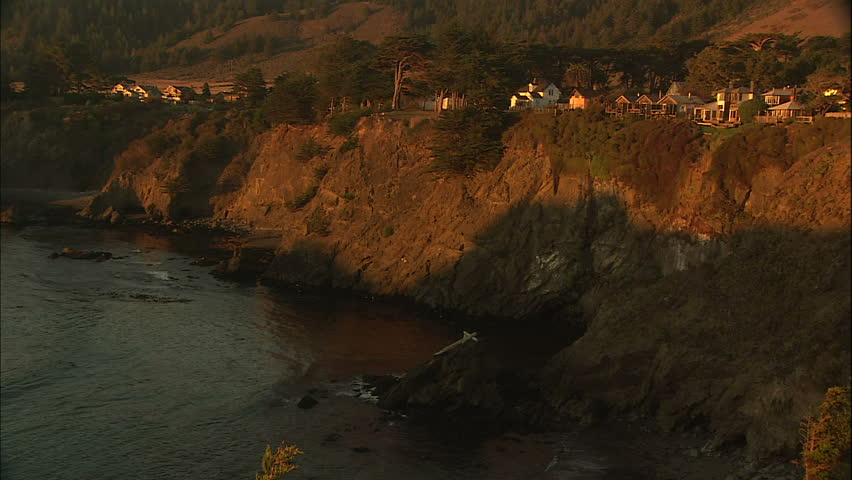 Warm Afternoon Sunlight Against Quaint Cliff Perched Coastal Town