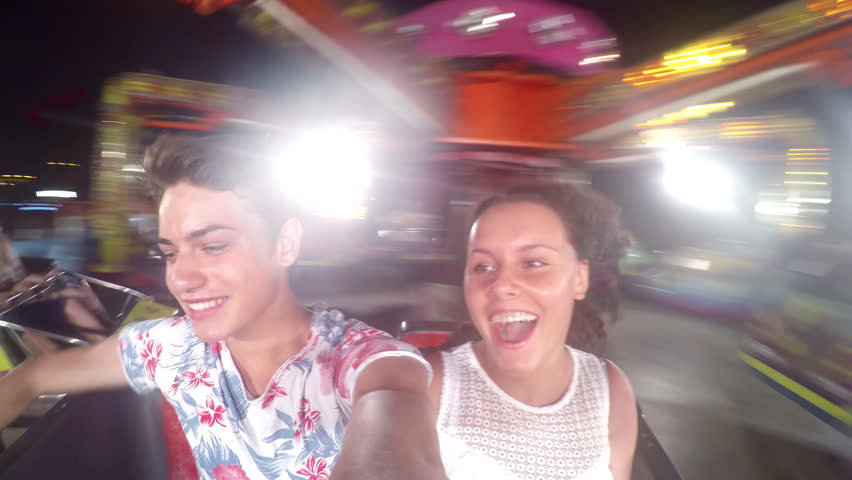Ride in motion in theme park during the evening, young couple fun | Shutterstock HD Video #14733847