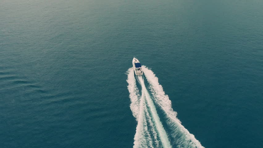 Aerial view of luxury speed boat cruising in the ocean.