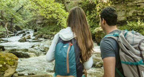 Hikers Exploring Forest River Couple Travel Nature Footage Trekking Enjoying Adventure Hiking Tourist Man Woman Beauty Vacation