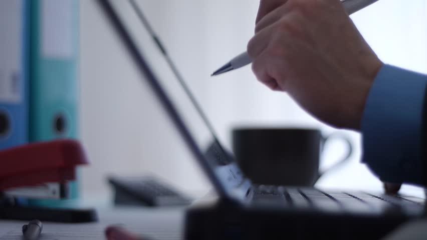 Working on laptop | Shutterstock HD Video #14756236