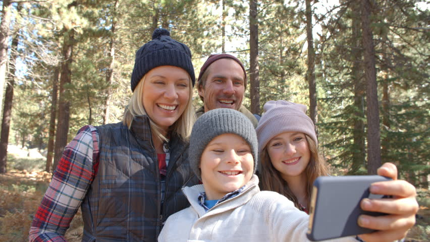 Boy taking family selfie in a forest with smartphone   Shutterstock HD Video #14757616