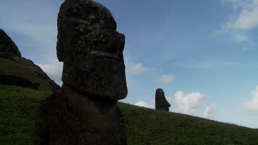 A time lapse of clouds moving behind Easter Island statues.