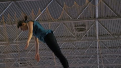Gymnast jumping on the trampoline, slow motion