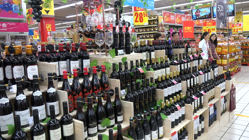 SHENZHEN, CHINA - 21 NOVEMBER 2015: Bottles of imported wine for sale at a French supermarket (Carrefour) in Shenzhen, China. Wine is an increasingly popular drink among middle class Chinese.