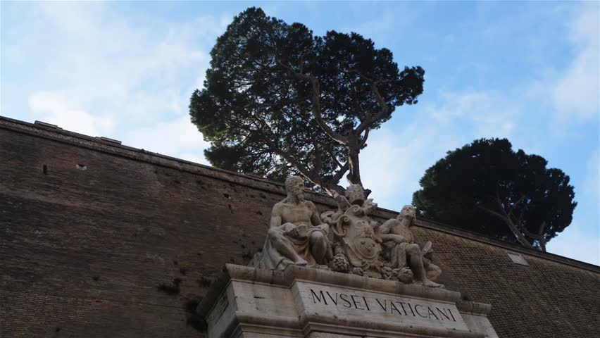 Sculptures above the entrance of Vatican Museums. Vatican Museums are the museums of the Vatican City and are located within the city's boundaries. #14831989