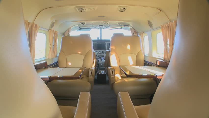 Dolly forward through the interior of a corporate luxury jet.