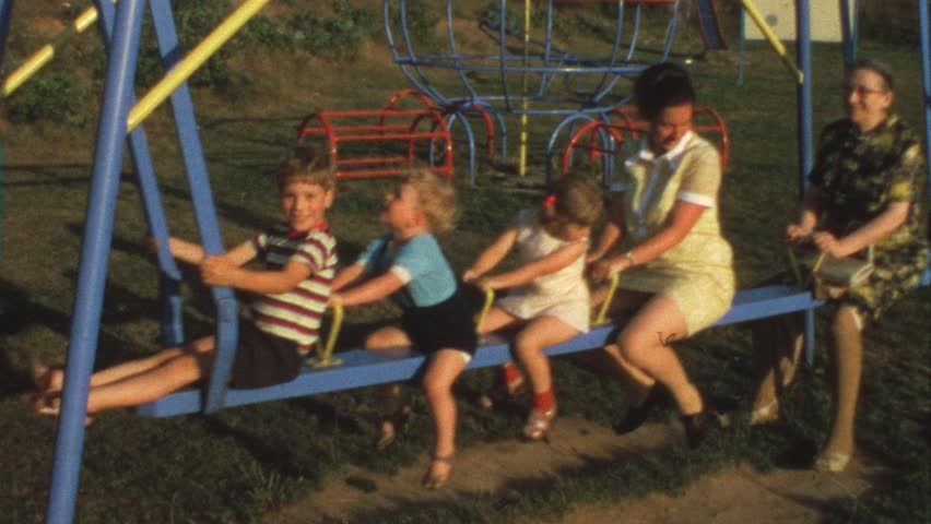 Mother, grandma and children on swing (vintage 8 mm film) #1486396
