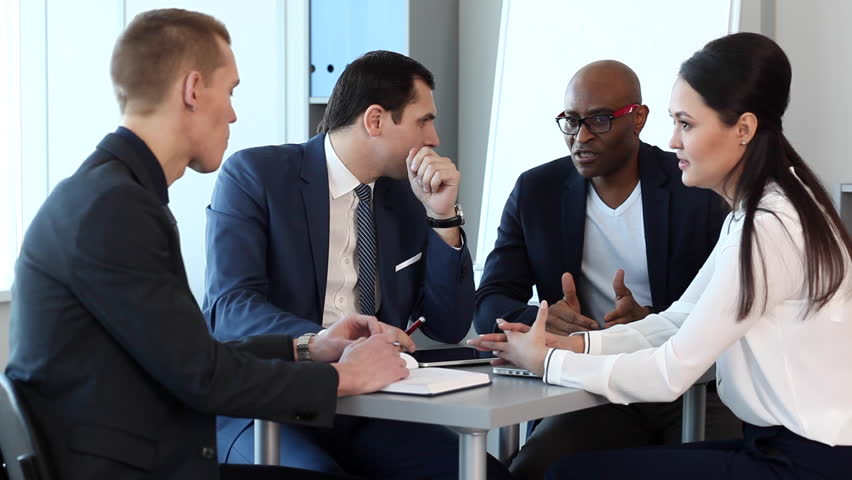 Team of four businessmen at the meeting in a bright and spacious office. Behind them, large windows, cabinets with folders, a flipchart/Meeting in the Spacious Office | Shutterstock HD Video #14875126