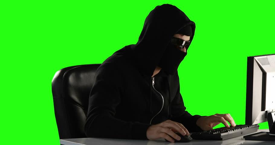 Computer hacker using computer on green screen | Shutterstock HD Video #14893006