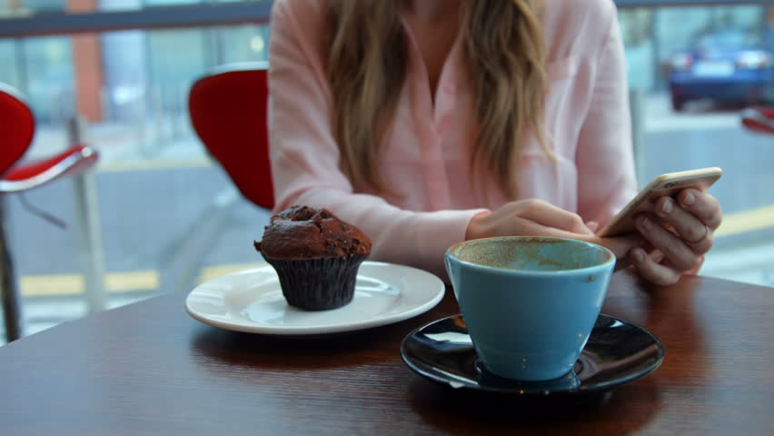 Pretty blonde having a coffee in high quality format - 4K stock footage clip