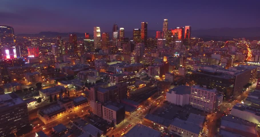 Beautiful aerial view of colorful illuminated city of downtown Los Angeles skyline at sunset twilight dusk night. 4K UHD.   Shutterstock HD Video #14914258