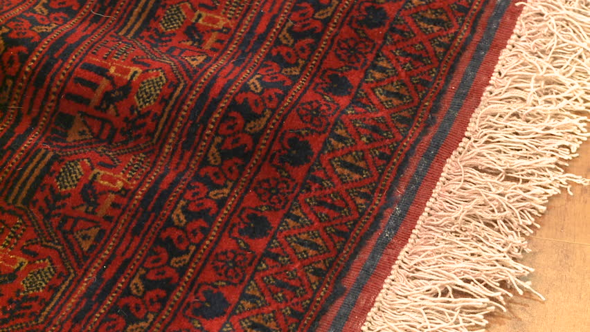 Rugs And Carpets Pan Left Right Across A Deep Red Woolen Persian Carpet With