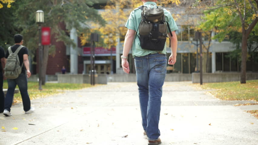 College student walking on a university campus.