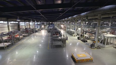 Ceramic tiles manufacturing , Industrial interior, AGV transports products,  AGV transports products, Electrical Automated Guided Vehicles Platform, Automatic stacker, AGV, modern plant, indoors