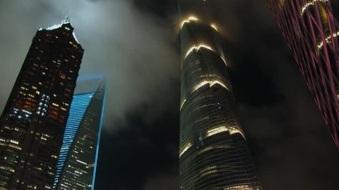MOSCOW - NOV 06, 2015: Top of Jin Mao Tower, Lotte Tower and World Financial Center skyscraper at cloudy evening. Timelapse