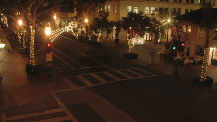 Night time lapse of State Street during the holidays in Santa Barbara, California.