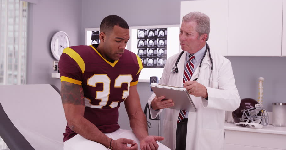 Handsome Football Player Having Doctor Stock Footage Video 100