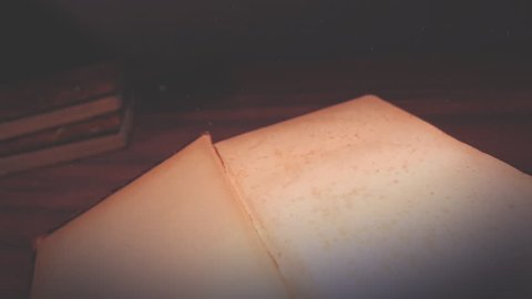 Old book opening to a white page