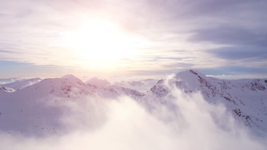 Epic Aerial Flight Through Mountain Clouds Towards Sunrise Beautiful Morning Peaks Inspirational Motivational Nature Background UHD 4K #15072076