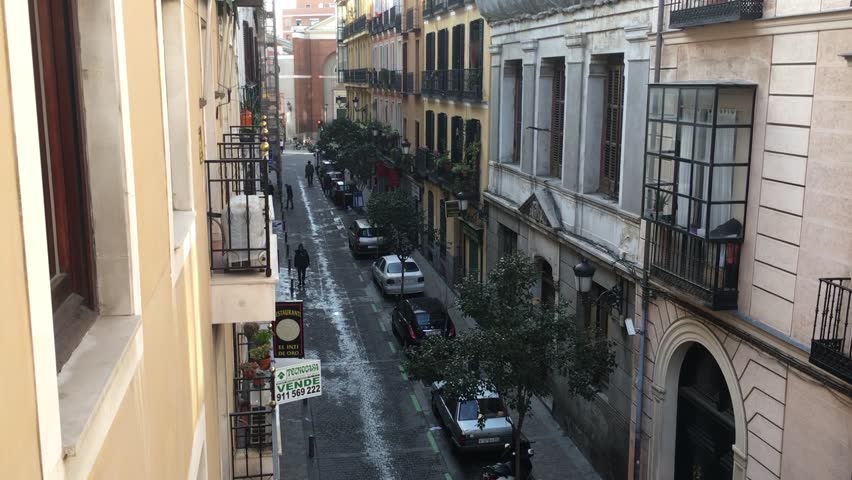?SPAIN, MADRID - JANUARY 27, 2016: City Madrid in Spain urban street with buildings with balcony and where parked cars | Shutterstock HD Video #15074926