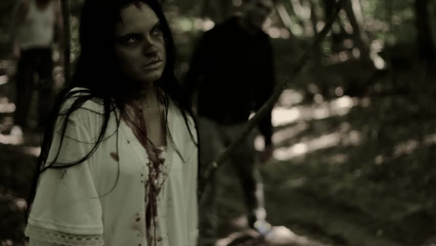 Group of zombies goes to the forest. zombie girl in a white shirt night, zombie guy in a jacket with a hood and a man crawling on the ground without half of his body. | Shutterstock HD Video #15082036