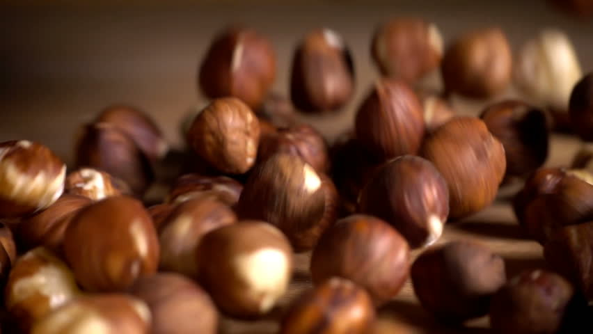 Hazelnuts pouring in slow motion