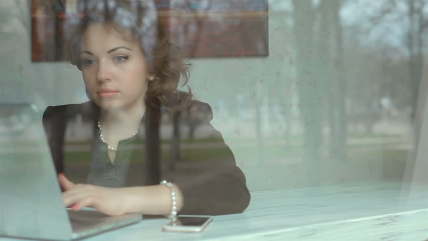 Pretty girl with a laptop and a smartphone | Shutterstock HD Video #15103546