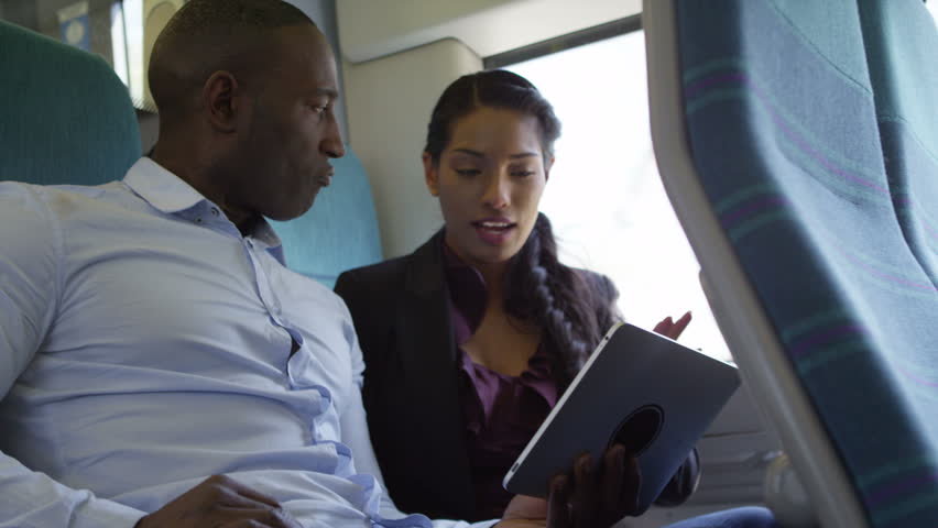 4k Happy attractive ethnic couple using computer tablet on train journey | Shutterstock HD Video #15194263