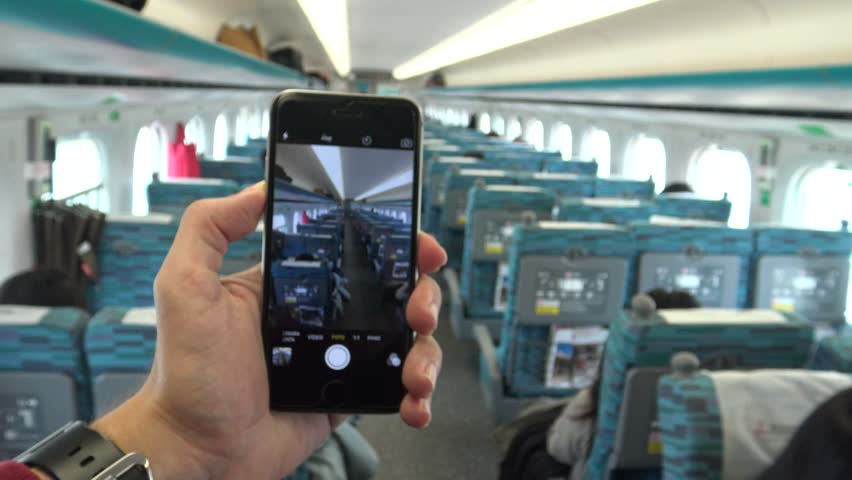4K Man using smartphone in the train to do some picture of the trip in the higth speed rail -Dan | Shutterstock HD Video #15198706