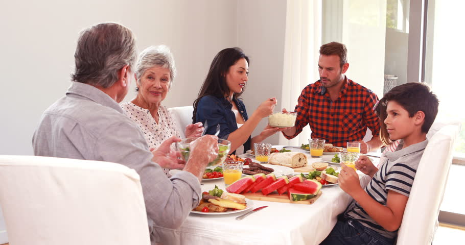 Happy family having a lunch at home | Shutterstock HD Video #15230236