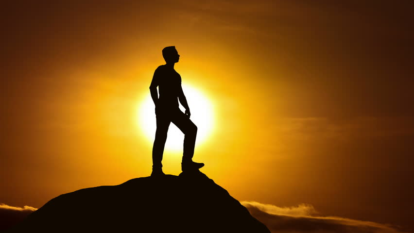 The man stand on a cliff on the background of sunset. Real time capture | Shutterstock HD Video #15236701
