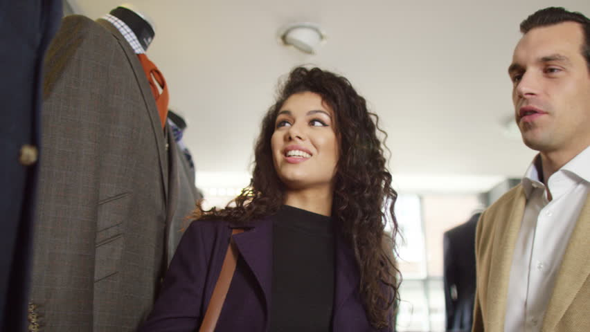 4K Attractive couple shopping for new suit in a man's clothing store   Shutterstock HD Video #15289066