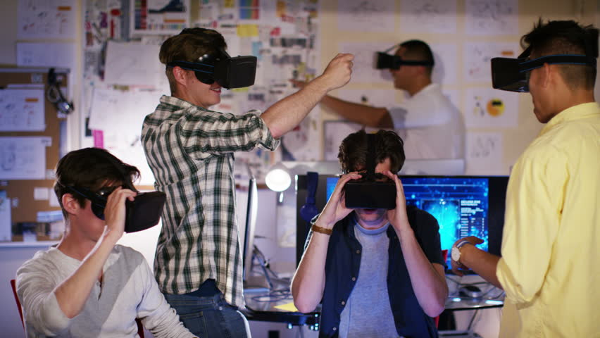 4K Group of young male computer gamers immersed in a virtual reality game