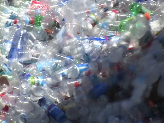 SANTA BARBARA, CA - CIRCA 2009: Thousands of plastic bottles pour out of a container in a recycling center circa 2009 in Santa Barbara.