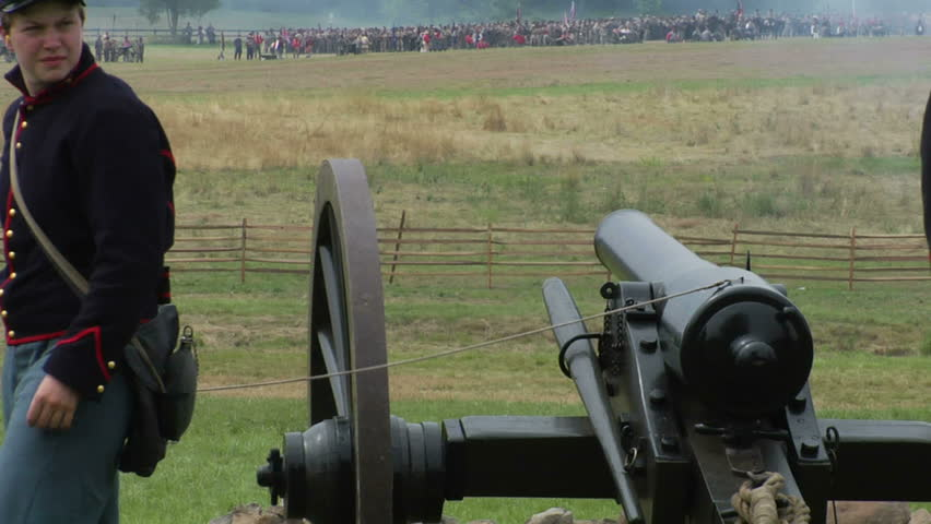GETTYSBURG, PENNSYLVANIA - JULY 2008 - large-scale, epic Civil War anniversary reenactment -- in the middle of battle.  Union Cannon and Artillery soldiers firing and fighting, cannons and smoke. boom